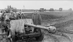 Waffen-SS troops can be seen standing next to their FlaK g… | Flickr