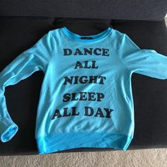 "Wildfox""Dance All Night Sleep All Day"" Pullover XS Wildfox ""Dance All Night Sleep All Day"" Pullover XS Super Comfy. Worn and washed once sweater pullover in Aqua in black writing. Like New. Baggy Beach Jumper Wildfox Sweaters Crew & Scoop Necks"