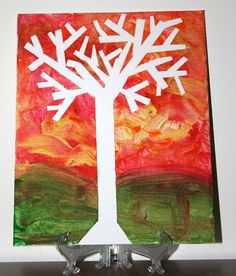 Put masking tape on a canvas in the shape of a tree.  Then, let your child paint over it.  Remove the tape once the paint is dry.  Inspired by Meet the Dubiens.