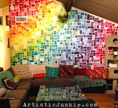 Paint chip wall LOVE this idea for using paint chip cards to decorate a wall! I really like the fact the blocks of color are not perfectly aligned.