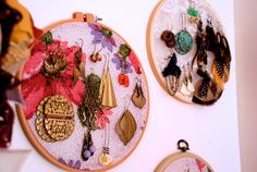 Earring holders! A much more attractive solution than the lace-in-a-frame idea.