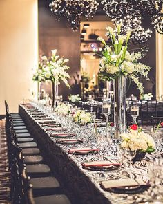 OMG so much I love about this photo and wedding we did last year... #blackchandeliers #longtable #blackandwhitelinen pop of #redtulips #tallcenterpieces #floatingcandels and so much more! @amabyaisha #wedding #weddingdetails #weddinginspritation #gettingmarried #weddingstyle #houstonweddingstylist #houstonweddingplanner #houstonwedding #makeepichappen #kcedesign #weddingphoto #weddingstylist #weddingdesign #followme  Check out more pics on our blog in our profile or http://ift.tt/1PtMtfA