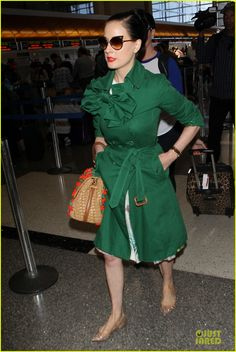 Dita Von Teese Brings Burlesque Show to Spain For the First Time: Photo #3159620. Dita Von Teese rocks a retro green coat while jetting out of LAX Airport on Friday (July 18) in Los Angeles.
