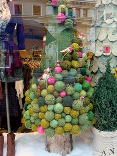 Yes, that's a Christmas tree-- covered in yarn balls and little birdies.  Apparently this was an Anthropologie window display last year.  Love it!