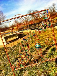 Copper Piping and Hand blown multi-colored glass yard art.   My own work! Artist Jen Degenhardt. This was my final project for 3D Design at the University of Missouri (Mizzou).   MIZ!!