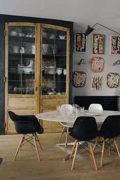 With six home renovations in their back pocket, Laure and her husband, Bertrand, have finally settled into a 20th-century artist's studio in the 15th arrondissement. A successful showing of Laure's contemporary works of art at Maison et Objet led to the creation of Maison Caumont—a line of vintage-inspired wallpaper, fabrics, and home accessories. The couple's eye for design is evident in their home's modern interiors and architectural details. In the dining room, midcentury furniture sits…