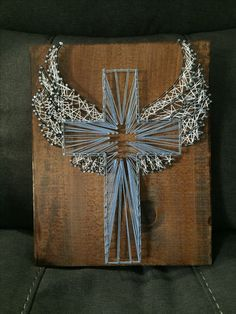Cross with angle wings string art