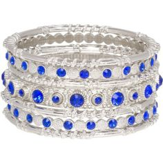 """Stunning Bangle Stack of 7 Silver Tone and Electric Royal Blue Bracelets Heirloom Finds. $19.99. Vivid pops of color with mesmerizing royal blue crystals. Layer these silver tone and crystal bracelets for an endless style selection!. Makes a great gift - arrives gift boxed!. Fashion forward with this fun style!. Bracelets are 8"""" with a 1 1/2"""" total width. Save 60%!"""