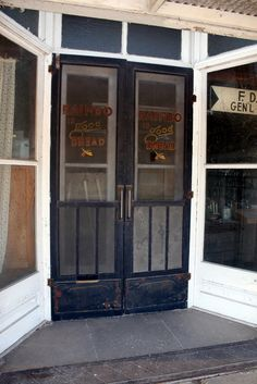 General store screen doors - I am so glad we have a few old shops like this where we live but all done up nicely Double Screen Doors, Vintage Screen Doors, Old Screen Doors, Wooden Screen Door, Vintage Doors, Old Doors, Window Screens, Vintage Ads, Vintage Prints