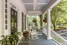 Craftsman Porch with Wrap around porch, Pathway, Fence, Dixie Seating Indoor/Outdoor Slat Rocking Chair - White