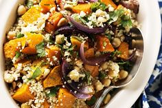Roasted pumpkin couscous 750g butternut pumpkin, 1 medium red onion, 1 T olive oil 2 tsp Moroccan seasoning 1 cup couscous 1 chicken stock cube 1 cup boiling water 2 x 125g cans chickpeas, 1/4 cup toasted pine nuts 1/4 cup roughly chopped fresh coriander leaves