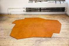 A Sense Of Place leather rugs- the 'via appia' rug is inspired by the road that connects Rome to Southern Italy
