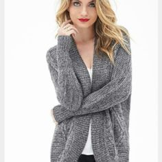 NWT Forever 21 charcoal cardigan New with tags Forever 21 charcoal cardigan with silver threading. Never worn! Size xs Forever 21 Sweaters Cardigans
