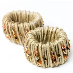 Fall Harvest Napkin Rings- The base is a toilet paper roll cut into four equal parts wrapped with twine/hemp. Use monofilament to add beads.