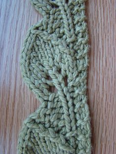 Ravelry: Leaf pattern by Susan B. Anderson.  If you use bulky yarn, it makes a great scarf.