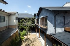 田中西春菜町の集合住宅 / 魚谷繁礼建築事務所 / 新建築 16.02 / 壁の共有という風景