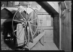 Mrs. Jacob Stooksbury, Loyston, Tennessee, at her spinning wheel, November 1933 by The U.S. National Archives, via Flickr