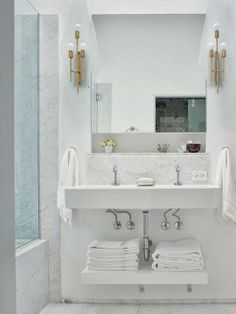 I like several things about this configuration: I like the shelf underneath for towels rather than a bulky cabinet. I would probably want only a single basin/faucet instead of the two I'm seeing here so that I had ample space around the sink for electric toothbrush, hair drier, etc. But I also like the ledge above the sink.