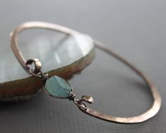 This bracelet hand forged with 12 gauge solid copper wire, hammered for more strength and style and accented with a nugget shape aquamarine stone