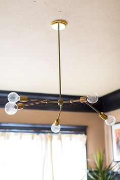 This Lindsey Adelman You Make It Chandelier took them weeks to figure out. Eventually they got help from Jenn's electrician dad.