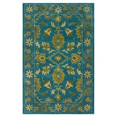 Wool rug with an overdyed botanical motif. Hand-tufted in India.  Product: RugConstruction Material: 100% WoolColor: TurquoiseFeatures:  Hand-tuftedMade in India Dimensions: 8' x 10'Note: Please be aware that actual colors may vary from those shown on your screen. Accent rugs may also not show the entire pattern that the corresponding area rugs have.Cleaning and Care: Spot treat with a mild detergent and water.  Professional cleaning is recommended if necessary.