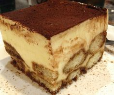 Olive Garden Tiramisu - an EASY recipe esp if you use store bought sponge cake Ingredients: 1 sponge cake, (10 to 12) 3 ounces strong brewed black coffee or espresso 3 ounces brandy or rum 1 1/2 pound cream cheese or mascarpone, room temperature 1 1/2 cup powdered sugar unsweetened cocoa powder...... Via http://saorganics.com
