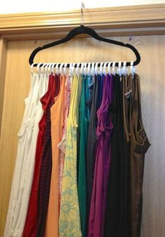 A cute and inexpensive way to store your tank tops. Simply use a hanger and shower curtain rings. Get the hanger from your closet, and the curtain rings from your local dollar store. Saves drawer and closet space! Tank Top Organization, Storage Organization, Closet Storage, Organizing Ideas, Trailer Organization, Organizing Solutions, Organising, Closet Shelves, Wardrobe Organisation