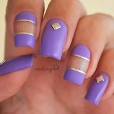 Matte Purple nail art design with gold foil and embellishments. The combination of purple and gold makes up for a very regal looking nail polish theme.