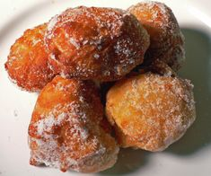 MALASADAS    There are those of us that so look forward to carnival season here….for the food.  One of the most common booths is the Malasada booth.  A Portuguese doughnut that Hawaii has become well known for at a handful of bakeries around the island