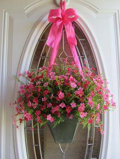 living basket with large ribbon to hang.