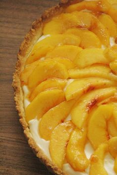 Sweet Mascarpone Peach Tart: A sweet cornmeal crust topped with tangy mascarpone filling and fresh peaches. Simple and elegant.