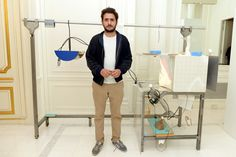 Neïl Beloufa, winner of the 6th edition of the Meurice Prize for contemporary art, in font of his project