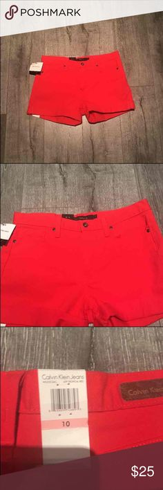 Calvin Klein red shorts NWT red Calvin Klein shorts. Fit right below belly button. Size 10 Calvin Klein Shorts Jean Shorts