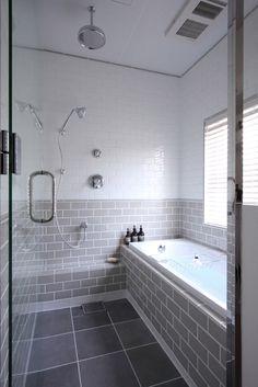 What a lovely bathroom tile combination. Half grey metro tiles - half white!