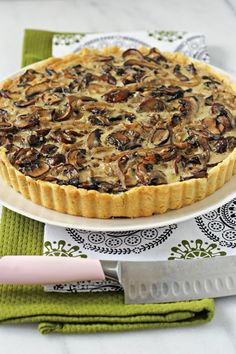 Recipe for a wild mushroom tart. A cornmeal crust filled with plenty of mushrooms, three kinds of cheese and fresh thyme.