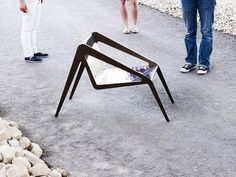 Swiss architects Studioforma's new spider-inspired Arachnide chair has long insect-like legs and a mirrored body that reflects its surroundings.