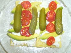 Avocado,Cottage Cheese,Chopped Chives,Gherkins and Cherry Tomatoe's on Corn Cruskies