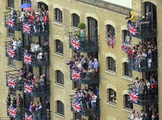 Balconies at Butlers Wharf, near Tower Bridge, provided an unbeatable view of the pageant