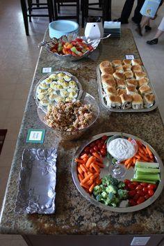 yummy baby shower food inspiration-chicken salad sandwiches on hawaiian rolls, veggies, fruit, deviled eggs, and pasta salad.