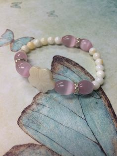 A personal favorite from my Etsy shop https://www.etsy.com/listing/245591904/hibiscus-white-and-pink-stretch-bracelet