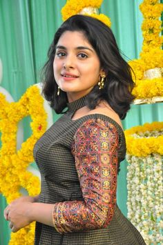 Nivetha Thomas at movie Muhurat. Nivetha Thomas Looking Beautiful in a Talasha Hyderabad long Dress, styled by Lavanya Bathina. Telugu actress Nivetha Thomas photos at her upcoming movie muhurat. South Indian Actress, Beautiful Indian Actress, Beautiful Actresses, Beautiful Women, Beautiful Bride, New Designer Dresses, Fashion Designer, Indian Designer Wear, Kurti Neck Designs