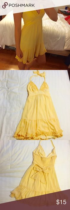 Cute Yellow Dress Cute Charlotte Russe flowy yellow mini dress. Halter top. Ties around neck and waist. Ruffles on bust and at the bottom. Dress has a sheer outer layer with yellow a slip underneath. Charlotte Russe Dresses Mini
