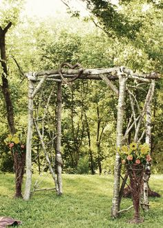 home made wedding arbor. Like this a lot minus the heart at the front.