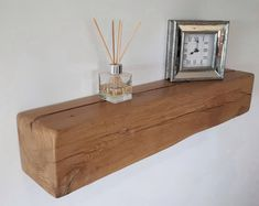 Stunning design and raw materials collide in this beautiful slab-style bar table / mantel. Each piece is completely unique and crafted from hand-selected reclaimed lumber. Use it as a wall mounted bar table or a unique mantel floating shelf! Floating Shelf Fixings, Reclaimed Wood Floating Shelves, Floating Bookshelves, Wood Bookshelves, Solid Wood Shelves, Wood Shelf, Oak Mantle, Fireplace Mantle, Rustic Mantel