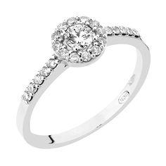 Kaunis ja näyttävä valkokultainen Precious-timanttisormus pyöreällä halo-istutuksella. Precious-sormus on tyylitietoisen naisen valinta. Upeaa sormusta koristaa yksi isompi timantti (0,17 ct) sekä sen ympärillä 22 pienempää timanttia (22 x 0,01 ct). Kohotetun istutuksensa ansiosta tämän sormuksen viereen asettuu esimerkiksi rivisormus oikein kauniisti. Keskikiviä kohden kapeneva runko luo sormukselle siron ulkomuodon. Timanttien laatu W/Si. Hinta: 2350 €. Malm, Engagement Rings, Jewelry, Enagement Rings, Wedding Rings, Jewlery, Jewerly, Schmuck, Jewels