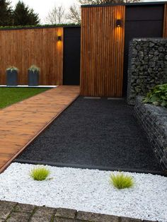 Basalt split in design garden modernfrontyard Basalt split is used in this moder. Basalt split in design garden modernfrontyard Basalt split is used in this moder. Modern Landscape Design, Modern Garden Design, Backyard Garden Design, Modern Landscaping, Backyard Patio, Backyard Landscaping, Black Rock Landscaping, Modern Design, Contemporary Design