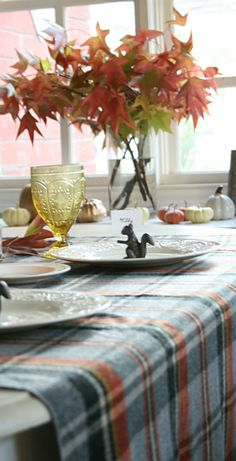 A beautiful plaid throw and a few vibrant leaves were the inspiration for our dinner table.  Have a lovely weekend!