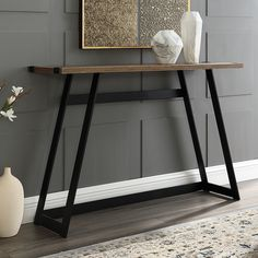 The Manor Park Urban Industrial Console Table makes a stunning addition in an entryway or next to a sofa. The modern-industrial design of this striking. Transitional Living Rooms, Transitional Decor, Industrial Console Tables, Urban Industrial, Industrial Design, Industrial Interiors, Entry Tables, Wood Laminate, High Quality Furniture