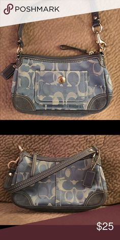 Coach handbag Small blue coach handbag. There is some wear on the suede leather bottom.  Otherwise it's in great condition. Coach Bags