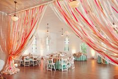 Crepe paper streamer curtains—love this idea! {Photo by The Nichols via Project Wedding}